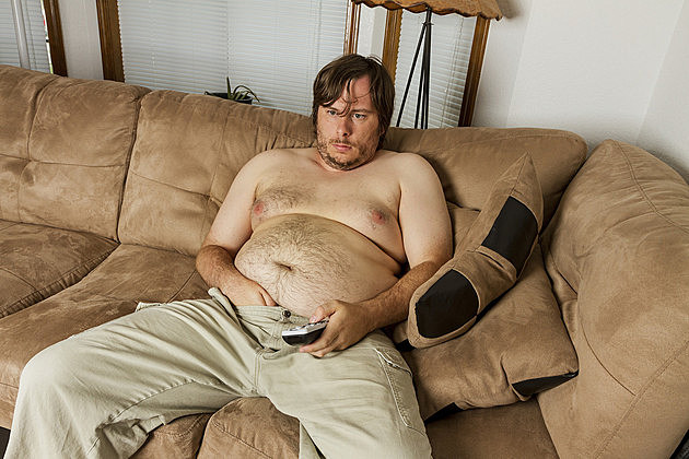 Shirtless Man Sitting on Couch